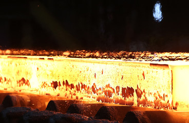 A slab of steel rolls down the line at the Novolipetsk Steel PAO steel mill in Farrell, Pennsylvania