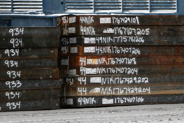 Slabs of marked steel wait in a yard before going into production at the Novolipetsk Steel PAO steel mill in Farrell, Pennsylvania