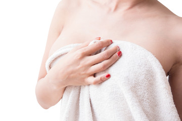 Asian girl's chest covering her breasts with white shower towel with white background