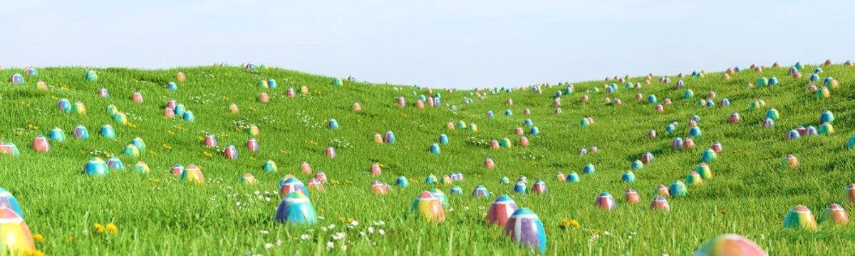 Bunte Ostereier zu Ostern im Gras einer Wiese