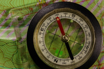 Magnetic compass is located on a topographic map