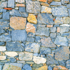 Blue and yellow stone wall, background, texture