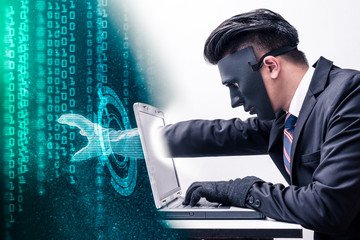 The abstract image of the hacker reach hand through a laptop screen for stealing the data as binary code. the concept of cyber attack, virus, malware, illegally and cyber security.