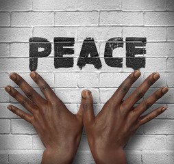 African hands on the wall with text Peace