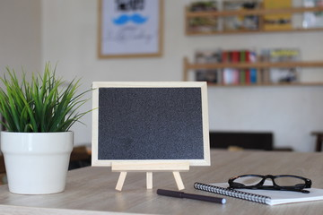 Blank chalk board for your text on wooden table