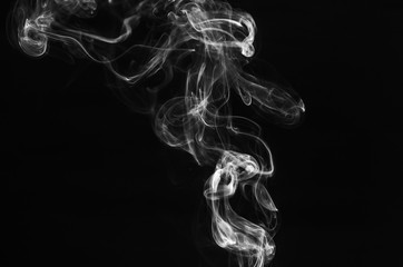 abstract movement of white smoke in dark background.