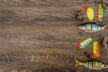 Fishing tackle on wooden background.