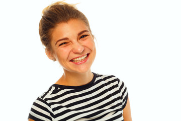 Beautiful young happy woman posing in studio over white background