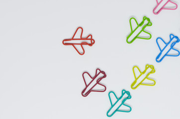 Business concept for group of plane paperclip point to one direction with another one red individual plane paperclip is point to another direction
