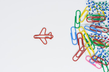 Business concept for group of stacked paperclip with another one red plane paperclip is point to another direction as a team leadership