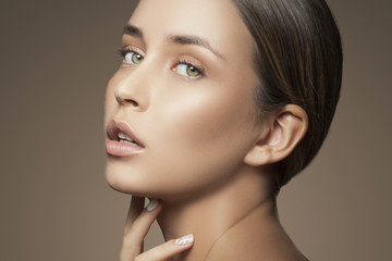 Sensual face of young caucasian model girl with nude makeup, natural lips and perfect clean fresh skin. Skincare facial treatment concept