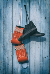 Black textile worn sneakers and red leather boxing gloves