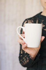 White Mug Mock up. Women Hand Holding Blank Mug. Styled Stock Product Image