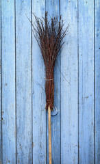 A broom with a wooden handle