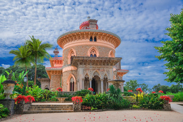 Beautiful artistic architecture of Monserrate palace of Sintra surrounded by colorful flowers in Portugal