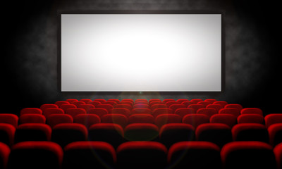 white screen and red seats in empty movie theater