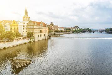 Prague with Vltava river from Charles bridge, sun rays