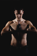 strong, athletic man on a black background