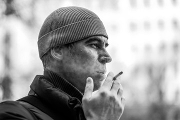 portrait of a man with a cigarette