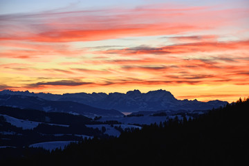 Colorful sunset on a cold winter day at the Saentis mountain, Switzerland
