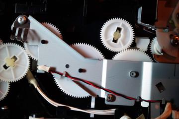 Gears, cogs and drive mechanism in modern inkjet printer.
