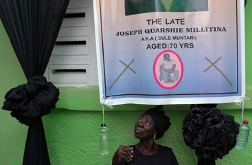 A relative of the late Joseph Quarshie Millitina, 70, sits at his compound as his body is being prepared for a funeral vigil at Zongo Junction in Accra