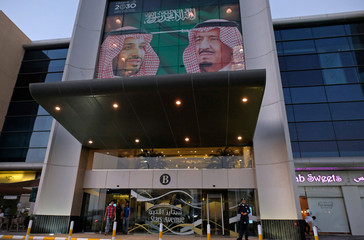A picture showing Saudi Arabia's King Salman bin Abdulaziz Al Saud and Crown Prince Mohammed bin Salman is seen on a mall in Jeddah