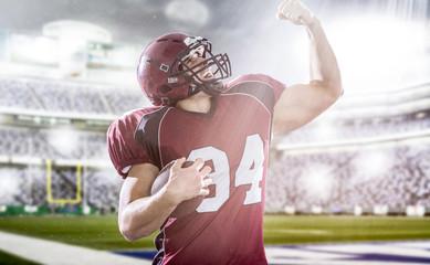 american football player celebrating touchdown
