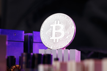 Picture of crypto currency, bitcoin and processor on pink background
