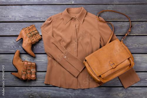 f368fffb62 Brown female clothing set. Flat lay