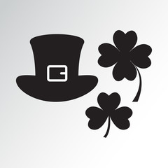 Hat and clovers from Saint Patrick's Day, black silhouettes. Vector illustration