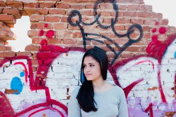 Brunette woman at crown graffiti