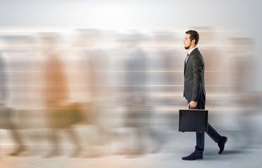 Businessman walking on a crowded street