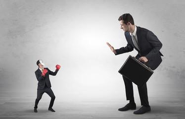 Businessman begging for small masked businessman