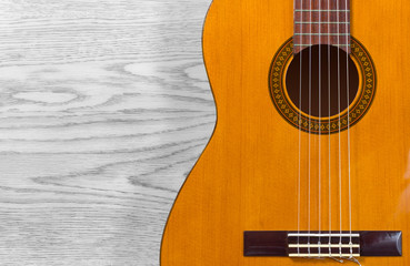 Classical Guitar over a Wooden Texture
