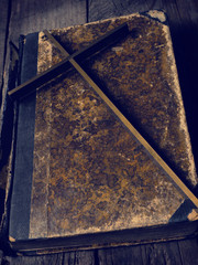 Old ancient book with a cross on a monestary table