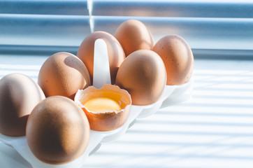 Cooking eggs from chicken eggs early in the morning in the kitchen.