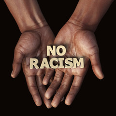 African hand with text No Racism