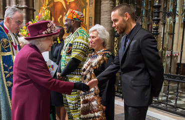 Britain's Queen Elizabeth meets Liam Payne after the Commonwealth Service at Westminster Abbey in London