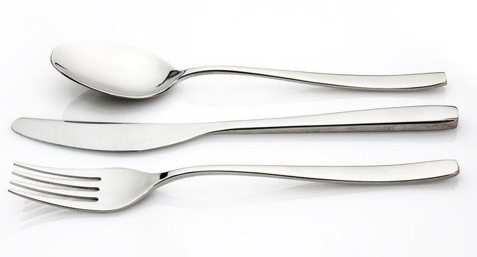 Isolated cutlery on a glossy white background