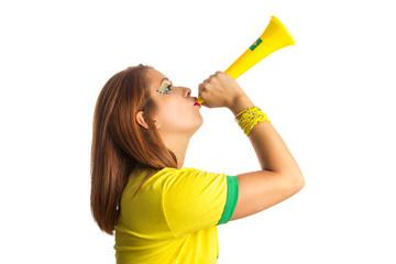 Brazilian woman fan celebrating on football match on white background. Brazil colors.