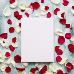 Mock up poster on wooden board with flowers petals. White canvas on stretcher. Romantic concept.
