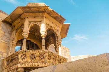 Close up of the arches of a rajasthani palace shot against a clear blue sky. This is Jaisalmer's famous sonar quila fort which is a popular tourist destination