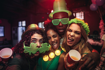 Friends having amazing celebration of St.Patrick's day at pub