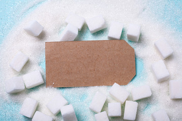 A pile of sugar on a green background. A frame, Copy space for text