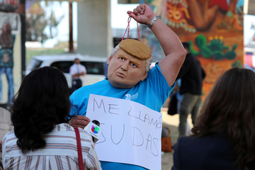 Activists and community groups hold a rally to condemn the visit of U.S. President Trump to California ahead of his visit to view border wall prototypes in San Diego