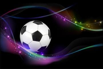 Soccer ball with colorful effects on black background.