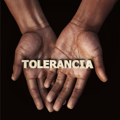 African hand with text Tolerancia