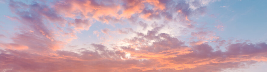 Fiery orange, pink and blue very beautiful sunset sky. Dramatic clouds after rain