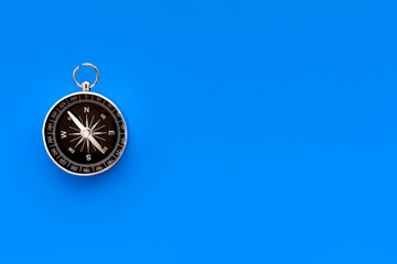 Direction concept with compass on blue background top view mockup